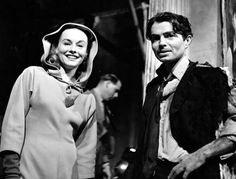"""James Mason welcomes visitor Paulette Goddard to the set of """"Odd Man Out"""", 1947, directed by Carol Reed."""