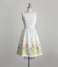 FLORAL DRESS 1960s Vintage White Floral Print Sun Dress by Carol Brent. $68.00, via Etsy.