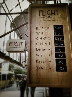 Flight Coffee - Wooden sign w/ simple print & chalkboard prices. Simple elegance.