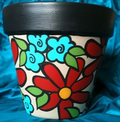 Check out this item in my Etsy shop https://www.etsy.com/listing/155936380/hand-painted-terracotta-pot-beautiful