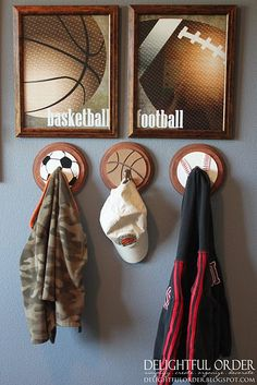 wooden sports pieces glued on wooden discs with hooks screwed on. i would do something besides balls. maybe something colorful? monsters?? with a monster trash can??