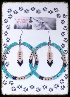 Handmade beaded feather hoop earrings.