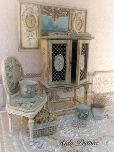 Cabinet of wood painted in white shabby, decorated with oil with grisailles. Doors with grid and two rosettes with flowers. Interor Colir Wood.