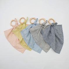 Our beloved teether blankie combines both sensory qualities of hard and soft. Young graspers enjoy holding the wooden ring and smooshing the blankie in their hands. When baby begins teething, the wood