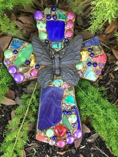 Custom mixed media mosaic cross w/ metal butterfly, cut stained glass, cored beads. K.C.'s Kreations