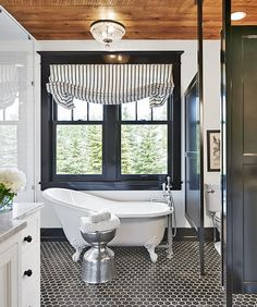 The black and white palette and wooden ceiling in this North Dakota bathroom represent each of the the homeowner's personalities.