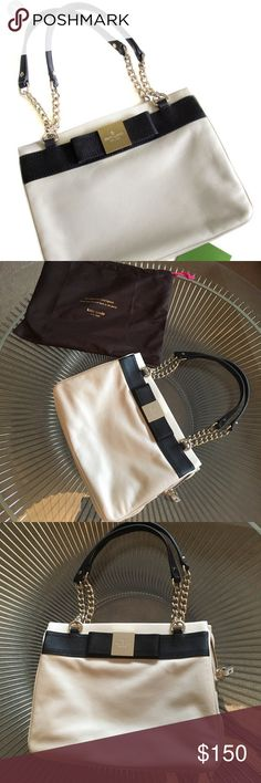 Kate Spade bow purse with chain link strap Kate Spade bow purse with chain link strap.  Beautiful Kate Spade purse with bow detail. Multiple zip compartments. Ivory/black.  Please see last picture for bag dimensions.  Bag comes with dust bag.  Only carried once!! kate spade Bags