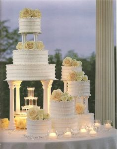 Rather than greek goddess, several different cakes on varried cake stands, at differnt heights?