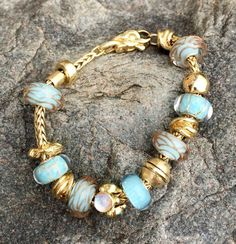Trollbeads - Turquoise and Gold. I don't normally like gold jewelry, but this is exquisite.