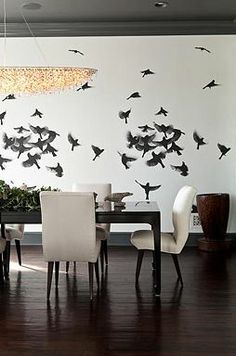 A photograph of a flock of birds is used as a wall mural in the dining room - a great substitute for classic wallpaper!