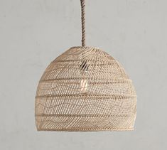 Woven of natural materials, the Flora Rattan Pendant adds softly diffused light to a room. A rope cord and bronze-finished frame complement the look of this lighting – a perfect choice for any space, whether a master bedroom or a small se Rattan Pendant Light, Pendant Light Fixtures, Rattan Light Fixture, Coastal Light Fixtures, Drum Pendant, Bedside Pendant Lights, Pendant Lighting Bedroom, Dining Lighting, Farmhouse Lighting