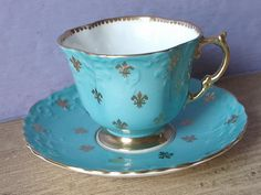 Antique 1930's Aynsley tea cup and saucer blue
