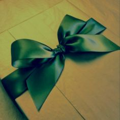 Dior pleated gift wrapping with a simple bow by Jane Means