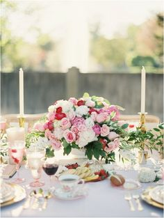 A gorgeous blush, pink and cream rose floral arrangement as centerpiece