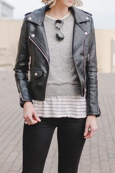 leather jacket with sweater, striped tee, and jeans, casual leather jacket outfit idea