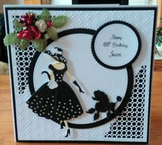7x7 card. Toppera made with Tattered Lace scalloped circle dies and pin for circles which are unbranded. The lady and the dog are Tattered Lace and the corners are unbranded dies from China. Flowers are from Hobbyhouse.