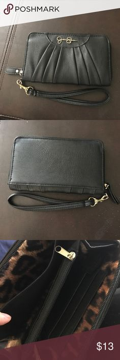 Jessica Simpson wallet Used but in great condition. Black with cheetah print inside. Fits three cards and also fits iPhone 7 Jessica Simpson Bags Wallets