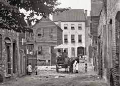 "Charleston, SC, circa 1920 ""Street scene with horse and wagon"" 4×5 inch nitrate negative by Arnold Genthe. via shorpy.com This is Bedon's alley looking north to Elliot Street."