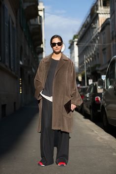 brown oversized coat and black wide leg pants with a pop of color - red shoes!