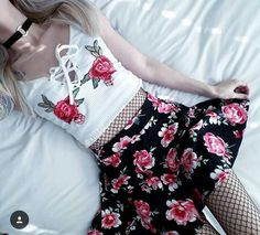 Grunge outfit with white rose crop top and fishnet body suit with rose skirt