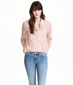 Check this out! Straight-cut shirt in airy cotton fabric with a collar, chest pocket, and long sleeves with buttons at cuffs. - Visit hm.com to see more.