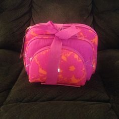 $5 Today Only! Pink and orange printed 3 piece cosmetic bag set. Large with printed pattern 9.5x7 in. Medium with pink solid pattern 8x5 in. Small with printed pattern 6x4.25 in. Never used or opened. All 3 have zipper closures with gold pink pulls. Price Firm. Dress Barn Bags Cosmetic Bags & Cases