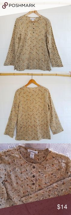 """Serengeti Tan Tunic w/Gold Embroidery Tan tunic by Serengeti catalog company with gold embroidered flowers. Three antique-brass buttons on placket. Long sleeves, notched hem. Polyester. Machine wash, cold. Very good condition; no flaws noted. Measurements (flat): chest/armpits 20"""", length 27"""", sleeve (under) 18"""". Serengeti Tops Tunics"""