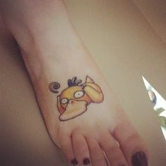 Psyduck tattoo and Pokemon tattoo