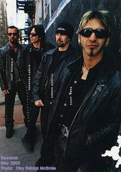 Godsmack ^.^ sully erna is way too hot for me to handle even the band and at the concerts too