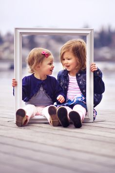 how cute!  @Aubrey Godden Godden Godden Dettmer, a photo idea? stick baby feet thru the frame