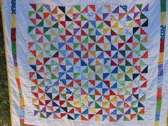 Spinning Rainbows Pinwheel Quilt by Koshka2, via Flickr