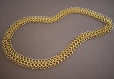 instructions on how to make chain mail.  granted you have to have the patience of a monk, but hey, now i know how to do it.  http://honestlywtf.com/diy/diy-chainmail-necklace/