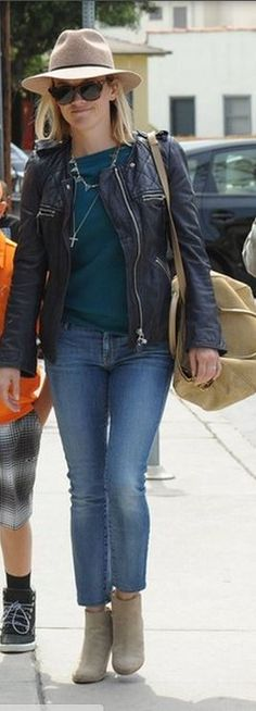 Who made Reese Witherspoon's blue leather jacket, sunglasses, glitter boots, and tan suede handbag?
