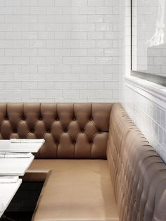 Cognac colored sofa by interior designer Richard Lindvall: