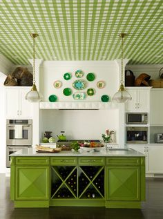 cool idea for the ceiling and love the green island and colors in the plate display