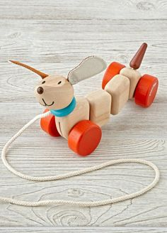 What makes this wooden dog pull toy so happy? It probably has something to do with his charming design and safe, water-based finish.