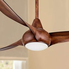Tropical flair blends with contemporary style, giving this ceiling fan a smooth, elegant look.