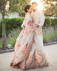 Can't stop ourselves admiring this beautiful couple. Her floral Lehenga twinning. - The Best Floral Outfits Indian Bridal Outfits, Indian Designer Outfits, Indian Dresses, Bridal Dresses, Indian Clothes, Pakistani Dresses, Pakistani Bridal, Bridal Lehenga, Bengali Wedding