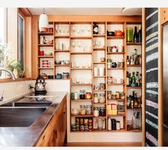 Shallow open shelves in a kitchen instead of cabinets.