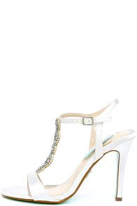 With luxe satin and pretty blue and diamond-like rhinestones, the Betsey Johnson Chloe Ivory Satin Rhinestone Dress Sandals are absolutely elegant! These pretty peep-toe heels have an adjustable ankle strap with silver buckle. #CuteDresses #TrendyTops, #FashionShoes #JuniorsClothing
