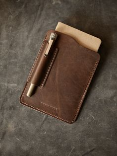 "Bas and Lokes Leather Goods - ""Dante"" Walnut Brown Handmade Leather Field Notes Sleeve, $99.00 (http://www.basandlokes.com/dante-walnut-brown-handmade-leather-field-notes-sleeve/)"