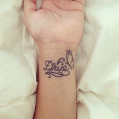 Wrist name tattoo daughter's name