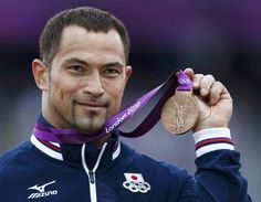 Koji Murofushi with his bronze medal.... (I really don't care what event he participated in, I'm too busy trying to close my mouth!)
