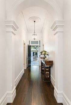 floor color off white walls - provincial + dark walnut? Victorian Hallway, Modern Victorian, Victorian Terrace, Victorian House Interiors, Victorian Homes, Style At Home, Dark Timber Flooring, Dark Walnut Floors, Flur Design