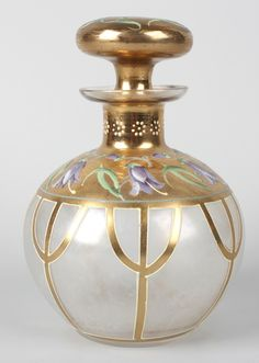 Lot 15 - A Moser glass perfume bottle, of bulbous form with wide gilt border decorated with purple enamel