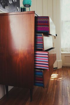 Genius: add a little personality to a thrifted dresser with fabric-edged drawers.