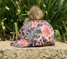 Jungle Queen pattern with Pom Pom. Made from 4 way stretch Lycra for the perfect fit on every size helmet cover. Jungle Queen, Helmet Covers, Pansies, Perfect Fit, Diys, Unicorn, Neon, Purple, Pattern