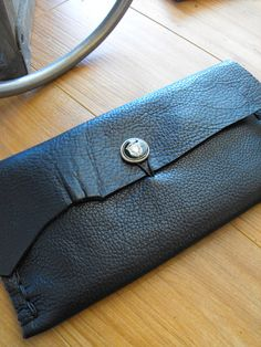 Hand tooled Italian leather clutch with vintage military button clasp!