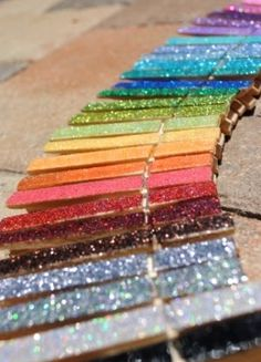 "Cover clothes pins with glitter, put a magnet on the back, and you have an instant way to display things on a board. ALSO...Mod Podge over the top of the glitter and it won't ""shed"" everywhere"