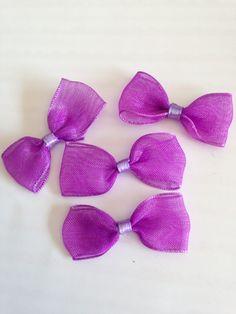 http://www.alittlemercerie.com/embellissements/fr_lot_de_quatre_noeuds_en_ruban_de_couleur_violette_-6772659.html